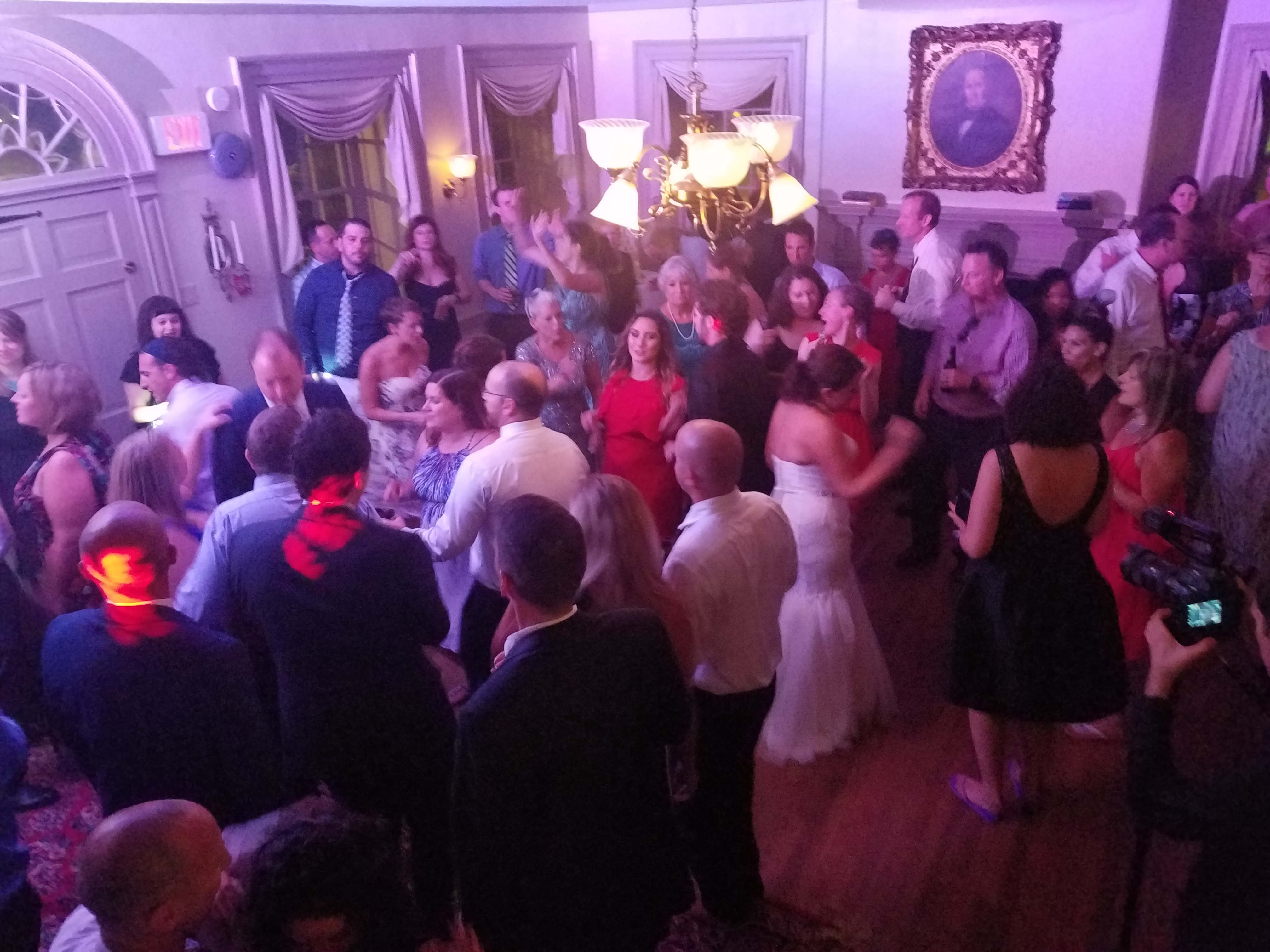 Bride dancing with her guests at a Wedding in Duportail House in Chesterbrook,Pa Chester county