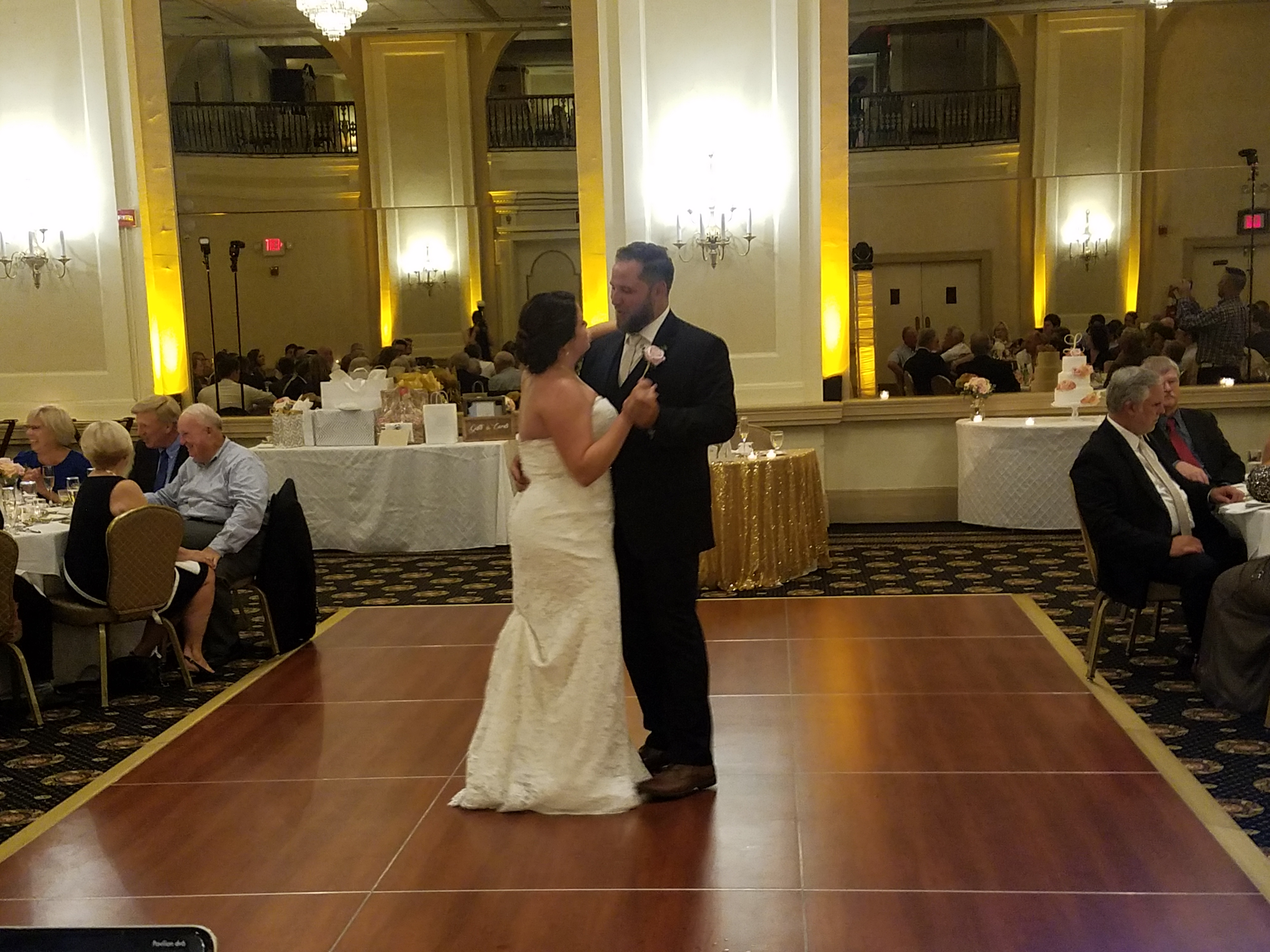 Kim & Greg's wedding First dance at The Historic Hotel Bethlehem in the Lehigh Valley with amber uplighting
